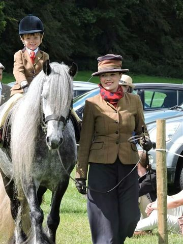 Grey fell pony with young rider Lewis Reynolds
